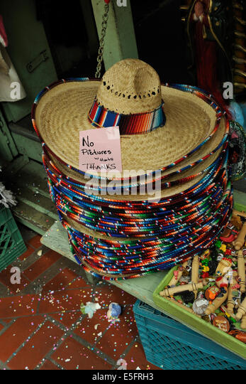 Mexican straw sombreros with sign barring being photographed wearing
