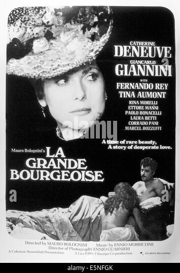 LA GRANDE BOURGEOISE, (aka FATTI DE GENTE PERBENE, aka THE MURRI AFFAIR), Catherine Deneuve (top), Giancarlo Giannini - Stock Image