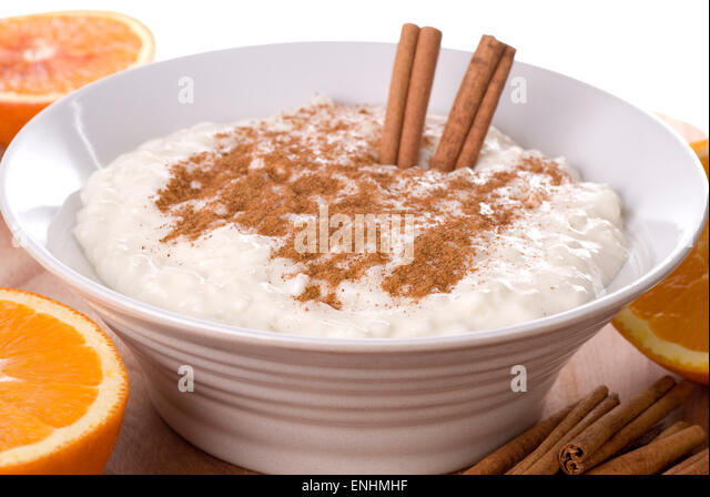 Rice pudding with cinnamon in a ceramic bowl. - Stock Image