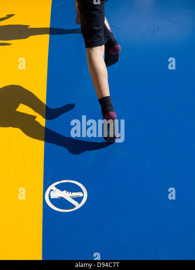 Person on bouncy castle - Stock Image