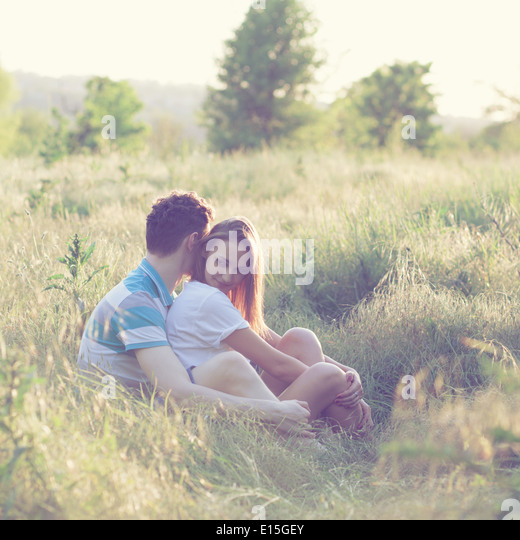 Young couple have romantic date at sunset - Stock-Bilder