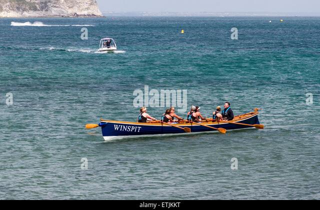 Cornish Pilot Gig, Winspit winning the sea rowing race. - Stock Image