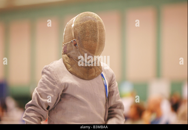 young man in fencing mask and lame ready for competition in fencing tourmnament - Stock Image