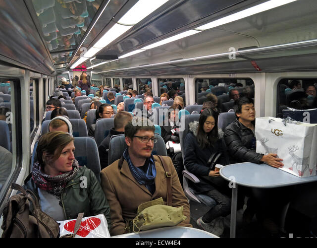 Crowded Arriva Wales Train Chester Holyhead with Xmas Shoppers - Stock Image