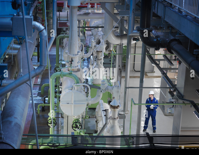 Engineer in Turbine Hall - Stock Image
