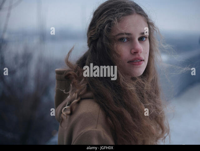 Portrait of wind blowing hair of serious Caucasian teenage girl - Stock Image