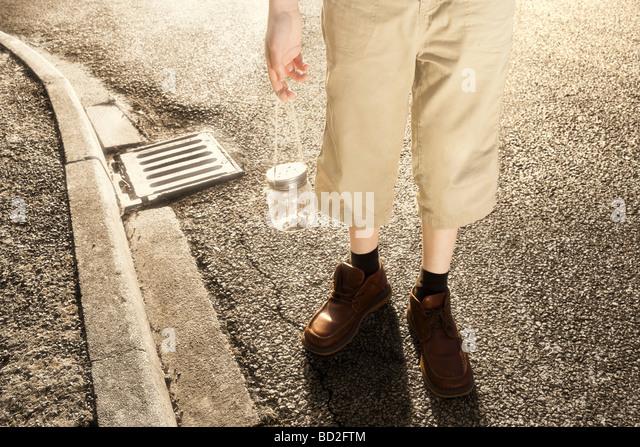 Abstract boy posing holding jar of worms - Stock-Bilder