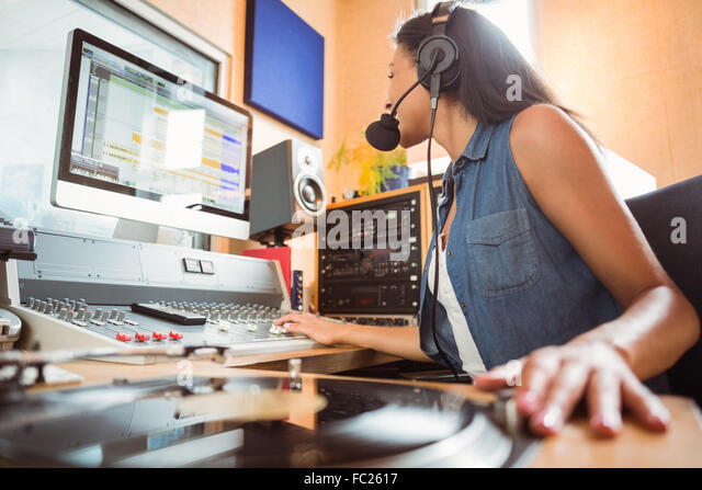 Portrait of an university student mixing audio - Stock Image