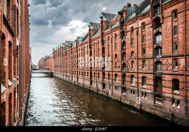 Panoramic view of famous Speicherstadt with dark clouds before the storm in Hamburg, Germany - Stock Image