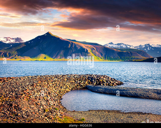 Dramatic summer morning in the Icelandic fjords. Colorful sunrise near the small town Grundarfjordur, Snaefellsnes - Stock Image