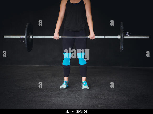 Health and fitness in the gym. Crossfit, weightlifting, equipment. - Stock Image
