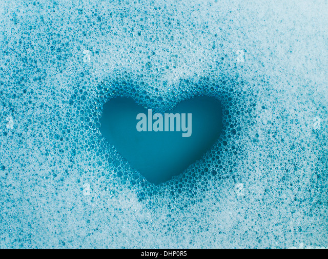 Heart shape created out of soap suds - Stock-Bilder