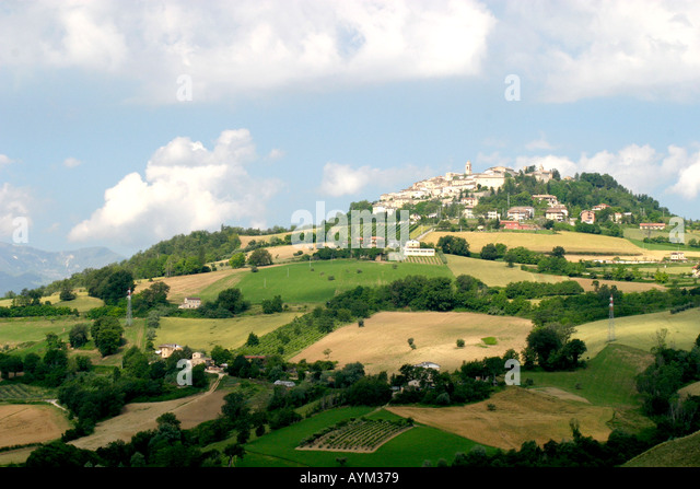 Distant view of Monte San Martino a hill town in the Le Marche province of Italy - Stock Image