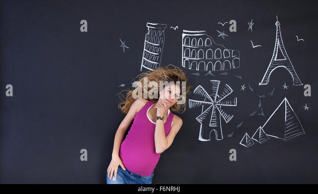 Young woman daydreaming about holidays and world attractions. Large copy space on left. - Stock Image