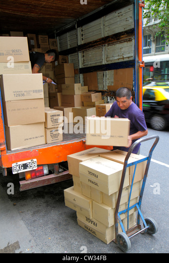 Buenos Aires Argentina Avenida de Mayo commercial delivery truck unload dolly cart hand truck box boxes cardboard - Stock Image