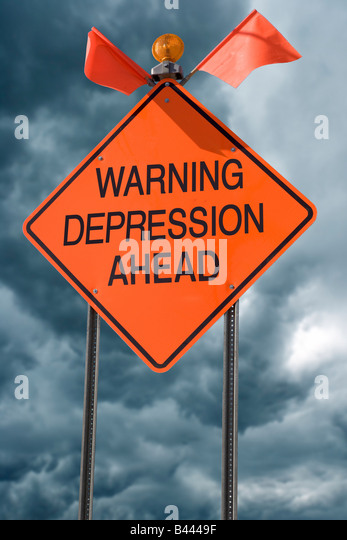 An orange highway safety sign with the words Warning Depression Ahead on it - Stock Image