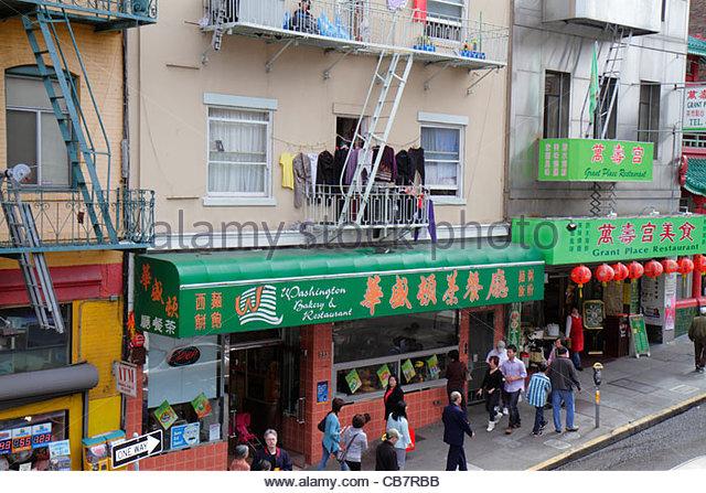 California San Francisco Chinatown ethnic neighborhood Washington Street business restaurant awning Chinese language - Stock Image