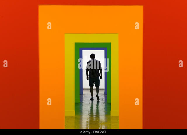 Karlsruhe, Germany. 11th July, 2013. A visitor of the Karlsruhe Academy of Fine Arts walks through a light-room - Stock Image