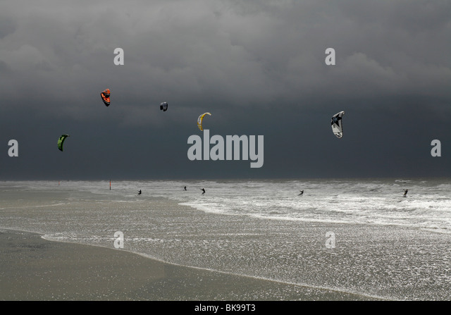 Kitesurfing during a storm on the North Sea, St. Peter Ording, Schleswig-Holstein, Germany, Europe - Stock Image
