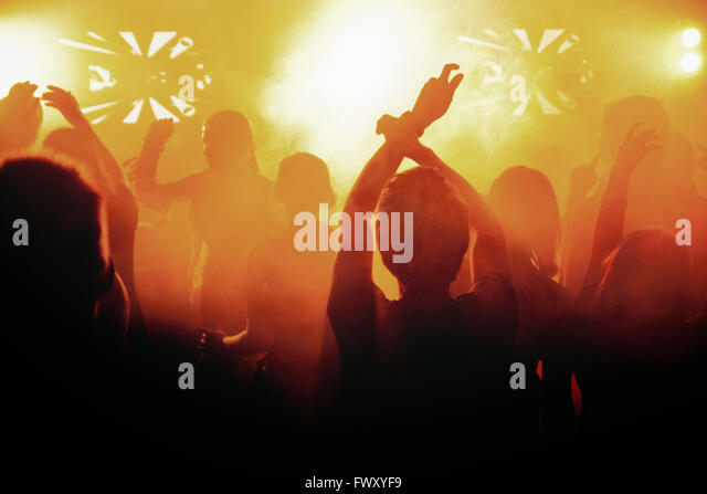 Finland, Silhouettes of people dancing at concert - Stock-Bilder