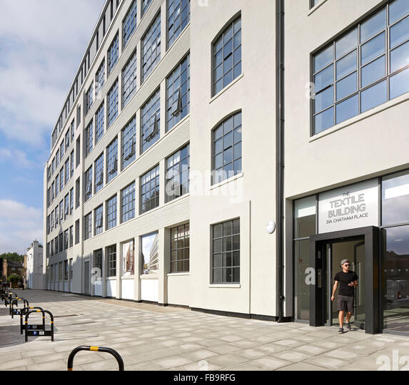 Facade perspective with main entrance. The Textile Building, London, United Kingdom. Architect: BGY, 2014. - Stock Image