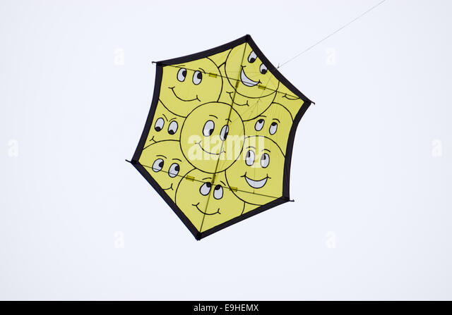 Smiley-kite on a kite-festival - Stock Image