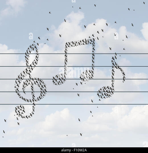 Music concept and recorded media distribution symbol as birds flying together shaped as musical notes as a metaphor - Stock Image