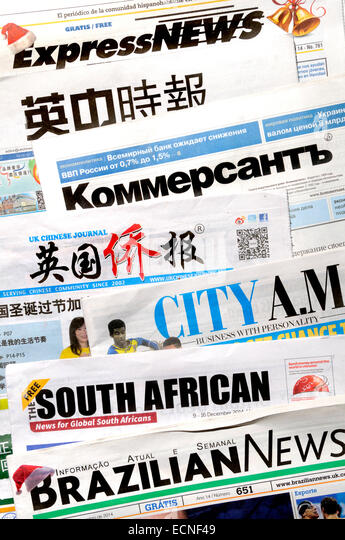 Free foreign newspapers available in London (December 2014) - Stock Image
