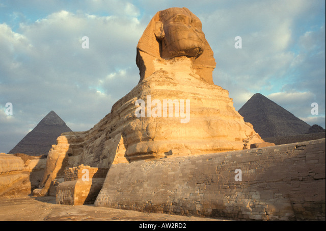 Egypt Sphinx portrait at Giza early morning with clouds - Stock Image