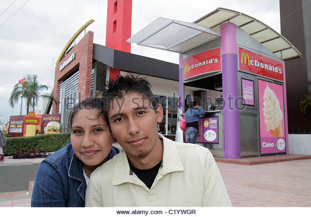 Cancun Mexico Yucatán Peninsula Quintana Roo Avenida Tulum Hispanic teen girl boy couple McDonald's global - Stock Image