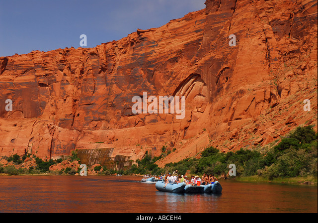 Arizona Glen Canyon white water rafts rafting Colorado River outdoor recreation red rock walls background no faces - Stock Image