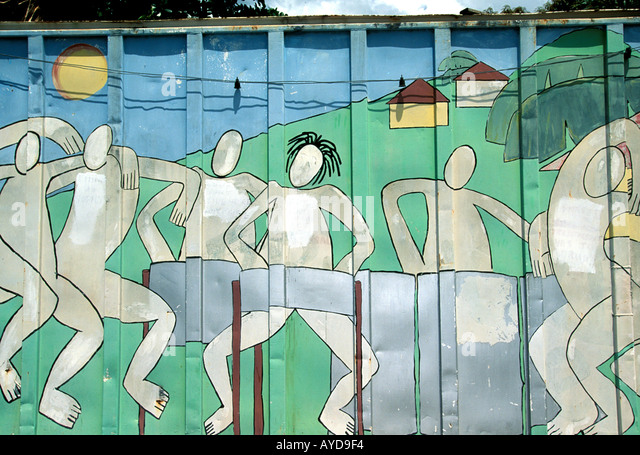 Trinidad Carnival painted fence around pan yard showing steel band musicians - Stock Image