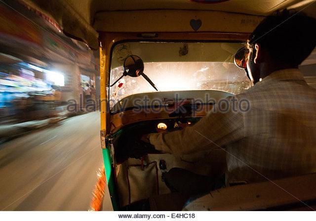 Speeding Through The Night Streets Of Varanasi, India - Stock-Bilder
