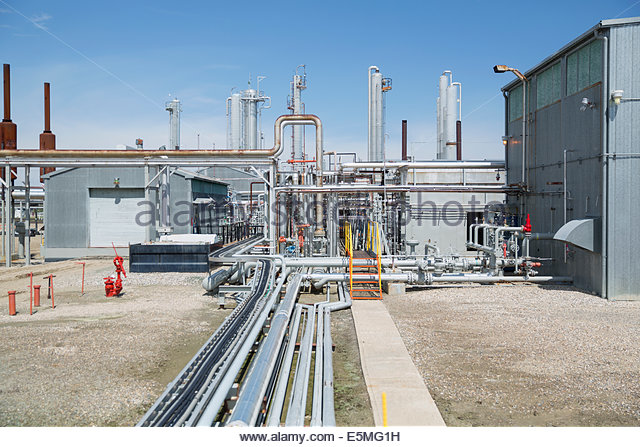 Pipes and equipment at gas plant - Stock Image