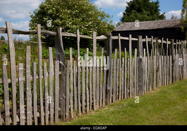 Rustic wooden Cleft fencing in English country garden,Oxfordshire,England - Stock Image