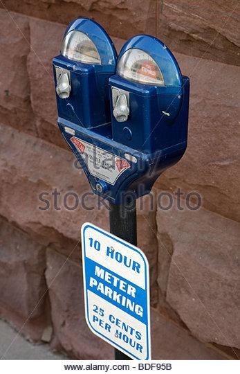 Michigan Upper Peninsula U.P. UP Lake Superior Marquette parking meter collect money blue - Stock Image