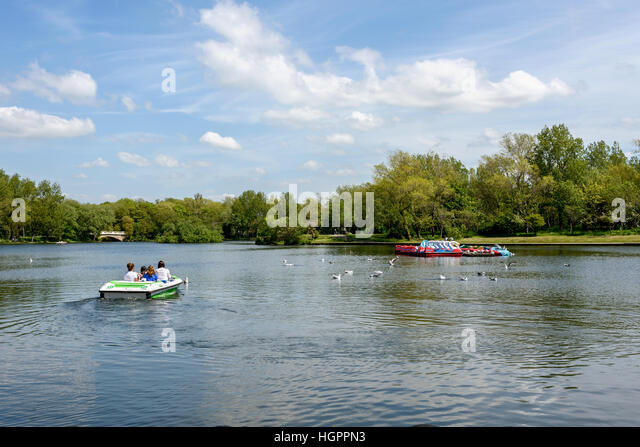 Boating Lake and rowing boat at Stanley Park, Blackpool, Lancashire, England. - Stock Image