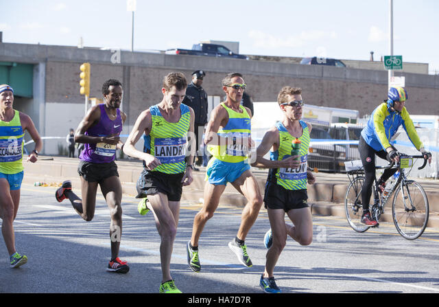 New York City Marathon runners on 4th Avenue in Brooklyn about 4 miles into the race. - Stock Image
