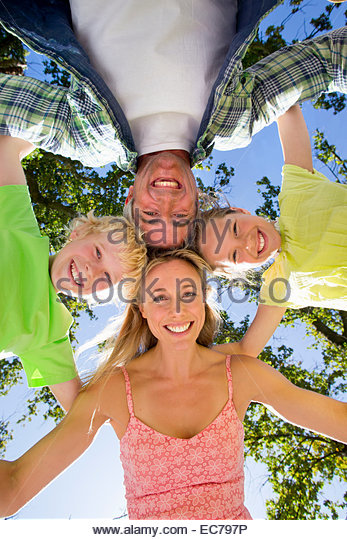 Portrait of a family in a group huddle - Stock Image