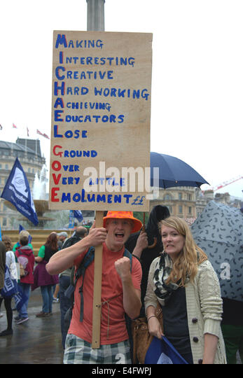 Trafalgar Square London UK 10th July 2014. Demonstrators shout and wave flags and banners as thousands of public - Stock Image