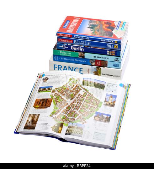 Pile of Travel guide books on white isolated - Stock-Bilder