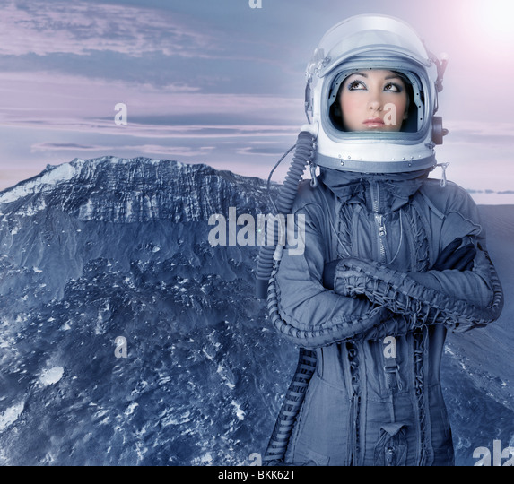 astronaut woman futuristic metaphor moon out space planets - Stock Image