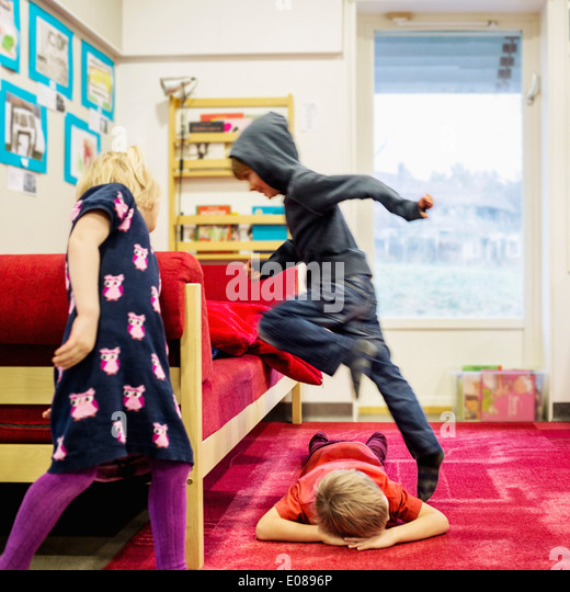 Kids playing in kindergarten - Stock Image