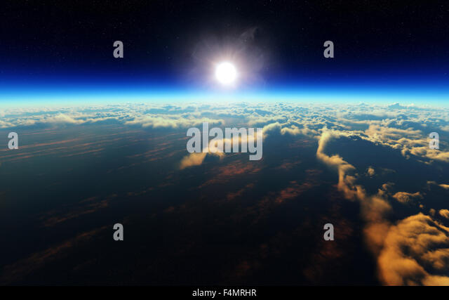 Planet Earth sunrise over cloudy ocean from outer space (3d artwork) - Stock Image