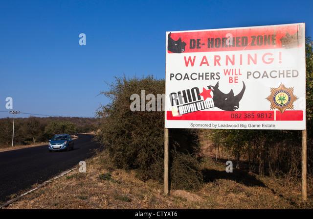 Sign warning against rhino poaching, Hoedspruit, South Africa - Stock Image
