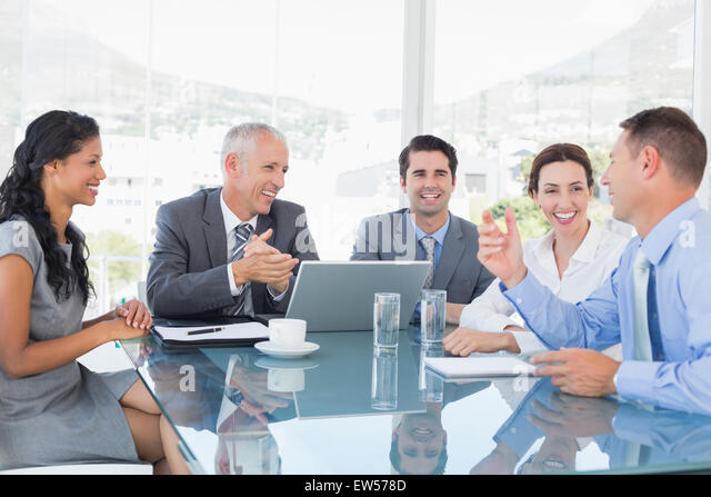 Business team laughing together - Stock Image