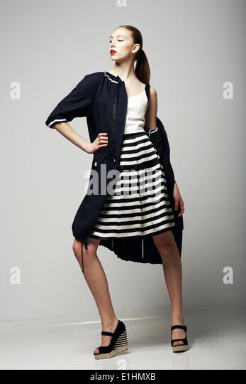 Ambitions. Confident Honorable Brunette in Black Waterproof Mackintosh. Vogue Style - Stock Image