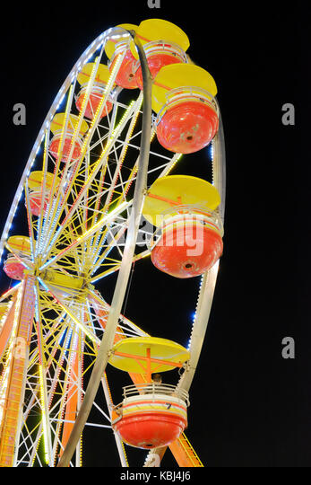 Carnival ferris wheel ride, at night, at the State Fair in Montgomery, Alabama United States. - Stock Image