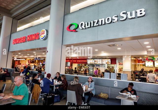 Charlotte North Carolina Charlotte Douglas International Airport inside terminal concourse gate area restaurant - Stock Image