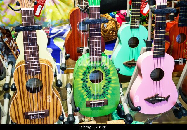 Hawaii Hawaiian Honolulu Waikiki Beach Ukulele House musical instruments sale display kiwi fruit theme humor humour - Stock Image